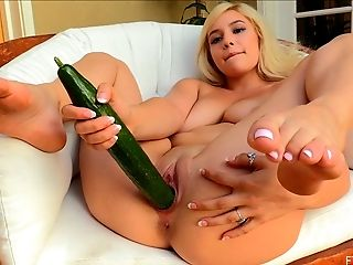 Blonde with perfect hooters uses the cucumber to masturbate