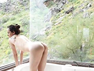 Home alone Lily pleasures her pussy while taking a nice bath