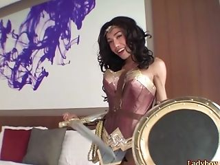 Gorgeous Thai shemale in a Wonder Woman cosplay outfit upskirts