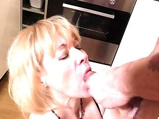 Mature lady Eva spreads her legs for a friend's penis in the kitchen