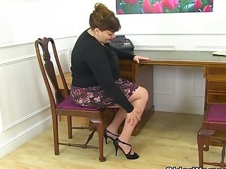 UK milf Vintage Fox gets busy at her desk