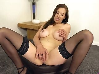 Stunning babe in black stuff is happy to play with her big boobs and pussy