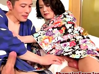 Kinky Japanese tgirl plays with cumload