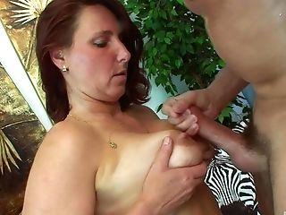 Redhead mature MILF Daniela gets her tits cum sprayed