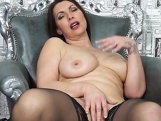 Chubby mature MILF Christine O. strips and masturbates with fingers