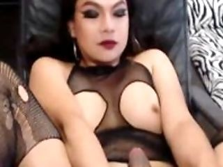 Shemale Strokes Cock While Stimulating Nipples