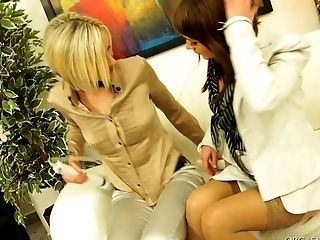 Kinky lesbians get wild stroking their muffs using vibrators on the couch