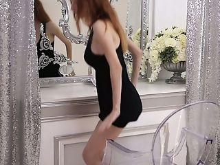 Petite red head with big fake boobies Helga Grey takes off her black dress