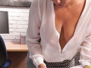 Sexy secretary in satin blouse Lu Elissa shows her cleavage