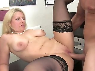 Middle aged blonde Zoey Tyler gives her head and provides her man with a great rimjob