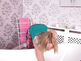 Sex-hungry blonde Ashley Rider is pleasing herself in the bathroom