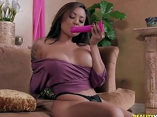 Busty babes Kate Kennedy and Kaylani Lei have fun with a strap on